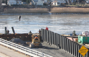 Despite temperatures in the single digits, construction continues on the West Front Street bridge on Tuesday afternoon.