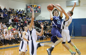 Matt Gray, (24) of Middletown South, attempts to block a shot by Louie Pillari (20) of CBA. Photo by Sean M. Simmons