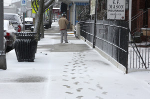 A pedestrian makes tracks along Ocean Avenue in Sea Bright at noon on Monday, Feb. 26.