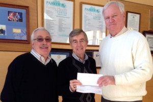 John Porzio, left, vice president and manager of Amboy Bank, Red Bank branch, looks on as John Horl, center, Parker Family Health Center vice president and treasurer, accepts a check from Joseph Mullane, vice president of Amboy Bank, Old Bridge branch.