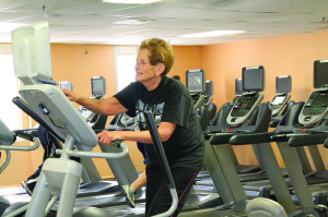 ": Dee Kaplan, Eatontown, comes to The Community YMCA Red Bank Family Health & Wellness Center almost every day. She swims twice a week and works out at the gym on the other days, favoring the elliptical machine. ""I was always active as an adult,"" said Kaplan, 74. ""I've belonged to Ys all over the country for 50 or 60 years."" Photo by Sean Simmons"