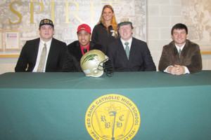 Red Bank Catholic High School students who signed letters of intent to play sports in college are: seated from left, Quenton Nelson, Shawn McCord, Tim O'Hara and Larry Redaelli; and standing, Grace Cornell. Photo by Vincent Landolfi, Jr.