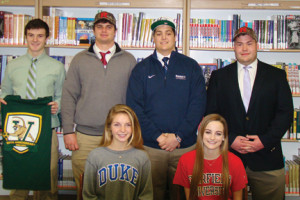 PHOTO: College sports-bound students from Rumson-Fair Haven Regional High School are: front row, from left, Schuyler DeBree and Bridget Miles and, back row, from left, Eamon Kitson, Donald Bedell, Peter Righi, and Jason Bryan.