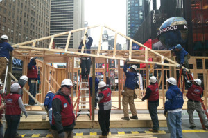 Volunteers from Habitat for Humanity and Lowe's home improvement centers build a home for the Morris family of Sea Bright in New York City's Times Square.