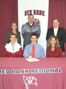 RBR senior Ryan Seely, seated, center, celebrates his signing a letter of intent to play lacrosse at Chestnut Hill College in Pennsylvania. Standing, from left, RBR Principal Risa Clay, RBR coach Dan Femminella and RBR assistant coach Mark Brown; and sitting, from left, Ryan's brother, Brayden, and his mother, Dana Seely. Photo courtesy Red Bank Regional