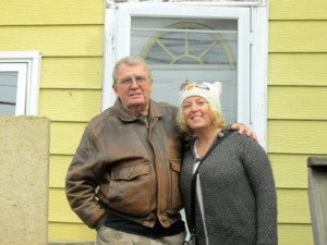 Tommy Johnson and his daughter, Leslie Johnson, stand in front of a family-owned home in Sea Bright, severely damaged by Sandy, and now being rebuilt through the efforts of Sea Bright Rising and the St. Bernard Project. Photo by John Burton