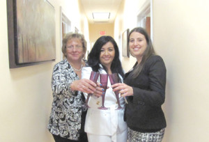 Lisa Alaimo, center, broker owner of Realty Connect Group, celebrates the opening of the new office with Arlene Fetta, left, and Kimberly Natale. Courtesy Realty Connect Group