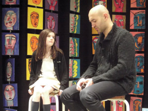 Fifth grade student Kathryn Johnston of Fair Haven seeks some personal advice about becoming an artist from Romanian contemporary artist, Dumitru Gorzo, who talked about his art and career during assemblies at Holy Cross School in Rumson.