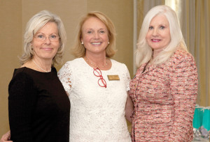 Joyce Wopat of the Rumson office, left, and Mary Burke, broker and owner of Heritage House Sotheby's International Realty, right, congratulate Elaine Eadon, the company's 2013 top producer, at the annual awards breakfast.