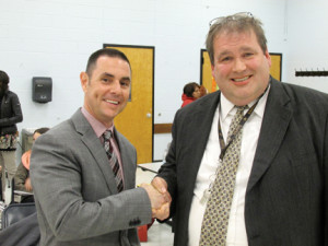 Red Bank Board of Education President Ben Forest welcomes Jared Rumage, the district's new superintendent of schools. His appointment was approved unanimously Tuesday night by the school board.