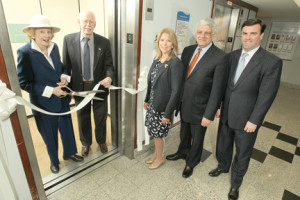 Monmouth Medical Center Foundation Trustee Gloria Nilson and her husband Len Nilson cut the ribbon dedicating a plaque naming an elevator in the hospital's main lobby in their honor. Also pictured are, from left, Tara Kelly; vice president, Monmouth Medical Center Foundation; Dr. Frank J. Vozos, president and chief executive officer, Monmouth Medical Center; and Bill Arnold, chief operating officer, Monmouth Medical Center.