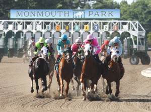 Horses leave the gate during a race last year. Racing at Monmouth Park will resume with a full schedule on May 10. -Courtesy Bill Denver/Equiphoto