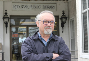 Former Red Bank Library Board of Trustees President John Grandits, in front of the library, 84 W. Front St., resigned along with six of the remaining seven trustees, in response to the borough council's actions regarding the library budget. The library director, Virginia Papandrea, who was scheduled to retire at the end of May, stepped down effective last Tuesday.