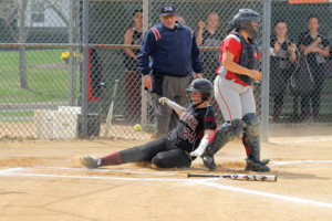 Lady Buc Brianna Pennington (24) crosses the plate to score one of the team's three runs in their 9-3 loss to the Spartans.