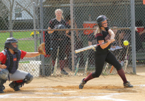 Katie Serkus (4), batting for the Lady Bucs, looks to connect on a pitch from Ocean's pitcher in the second inning.