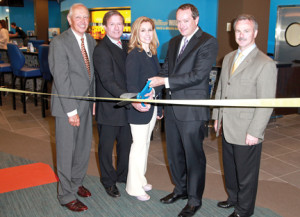 Cutting the ribbon to open the new William Hill Race & Sports Bar at Monmouth Park are, from left, Robert Kulina, president of Darby Development, operator of the racetrack; Dennis Drazin, advisor to Darby Development; Nona Balaban, president of the Thoroughbred Breeders Association of New Jersey; Joe Asher, CEO of William Hill US; and Oceanport Mayor Michael Mahan. Photo by Bill Denver/EQUI-PHOTO