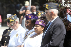 Men and women veterans reflect during Red Banks Memorial Day service at the Veterans Monument on Monmouth street Monday morning, May 26th 2014.  Scott Longfield