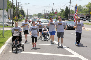 The 31st annual New Jersey Law Enforcement torch run to support the Special Olympics of New Jersey Summer Games was held Friday and run through Two River Area towns. Middletown police officers carry the torch up Route 35 after members of the Red Bank Police Department handed the torch over on the Coopers Bridge. The run started in South Jersey and ended in Woodbridge.  Photo By Scott Longfield