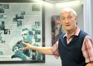 Paul Zigo, Brookdale Community College associate professor of history, talks about the work of World War II photographer Al Meserlin, which is on display at the college. --Photo by John Burton