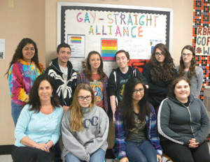 Members of the RBR Gay-Straight Alliance working on the upcoming Gayla at the school are: from left, seated, GSA advisor Stacy Liss, Natalie Gunderson, Sofia Dadap and Cecelia Gunderson; standing, Courtney Ravelo, James Fogerty, Leah Roberts, GSA President Siobhan Hanson and Cori McQuillen. Photo Courtesy RBR