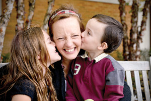 Bridget Wallin gets kisses from her children Kiera, 7, and 3-year-old Aiden. Courtesy Bridget Wallin