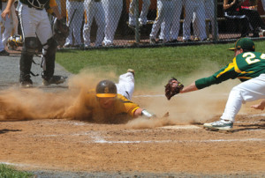 Anthony LaVigne dives safely into home plate and scores for SJV as RBC's pitcher, Tom Puza, attempts the tag.