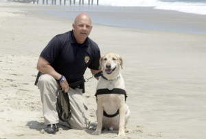 Monmouth County Sheriff's Officer Kroeper with his K-( unit partner, Evan. Evan has recently been diagnosed with cancer.