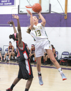 Grace Fallon takes a shot, good for two points in a playoff game against Neptune in January at Rumson-Fair Haven Regional High School. --Photo by Sean Simmons