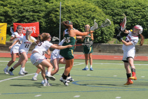 Red Bank Catholic's Julie Krasutsky fires a rocket past Summit goaltender Kady Glynn for a goal. --Photo by Sean Simmons