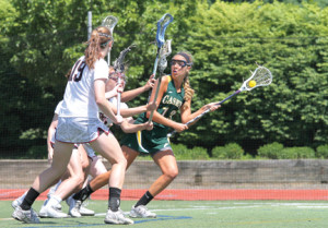 Senior Casey Grace Fallon looks to pass the ball during second-half action. Fallon will be playing lacrosse for Duke next season. --Photo by Sean Simmons