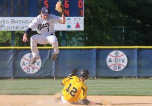 St. John Vianney's Chris Loney slides safely into second base on a steal as Christian Brothers Academy shortstop Mark Mancuso leaps for the ball. --Photo by Sean Simmons