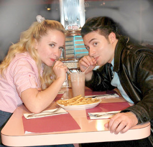 "Sandy, played by Maggie Bera, and Danny, played by Phil Mazzara, sip a soda at the sock hop in Phoenix Productions' revival of the Broadway musical, ""Grease."" The musical will be on stage July 11-20 at the Count Basie Theatre in Red Bank. --Courtesy Phoenix Productions"