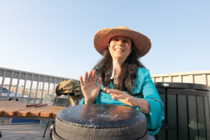 Dorothy Sikora, drum facilitator, offers a beat during a monday night drum circle in Sea Bright.