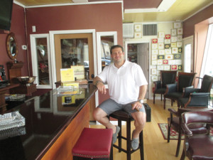 Owner Steve DiGiorgio relaxes at the bar of his new cigar lounge and smoke shop, Up In Smoke On Main Street in Belford.  --Courtesy Up in Smoke on Main Street