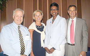 The Community YMCA President and CEO Rhonda Anderson, second from right, congratulates re-elected board officers, from left, Treasurer John Badenhop of Little Silver; Board of Directors Chairperson and Chief Volunteer Officer Patricia Whittemore of Rumson and Vice Chairman Joseph Oriolo of Shrewsbury.