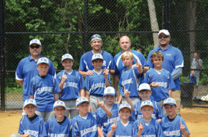 The 10U Fair Haven Diamonds players celebrate their victory in the U.S. Amateur Baseball League's championship game. The are: front row, from left, Nico Calabretta, Joey Gotch, Nick Marchakitus, Matt Rigby, Matt Fernandez, Colin Kennedy, Shay Addison and Brian Doherty; middle row, Robbie Thomson, Luke Ronayne, Matt Cruz, Lucas Kostulias and Scott Gyimesi; and back row, coaches Pete Gotch, Rafe Fernandez, James Kostulias and Steve Gyimesi. --Photo by John LoGioco