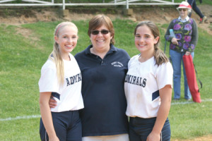 Kamryn Hubeny, left, and Emma Curry, right, share great memories with coach Kathy Nolan of their 34-1 three-year record on the middle school softball team at Henry Hudson Regional.  --Photo by Adam Hubeny