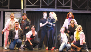 """Together"" is sung by Danny Zuko (Philip Mazzara) and Sandy (Maggie Bera), center, and the cast members of Phoenix Production's production of ""Grease."""