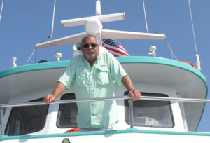 Tom Buban, captain of the Atlantic Star, oversees the morning cruise Monday which brought 30 passengers out into Sandy Hook Bay for 4 ½ hours of fishing. Photo by John Burton