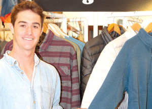Jake O'Donnell stocks his store, Jake's Surf Shop in Sea Bright, with surf gear and brand-name clothing.