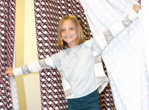 Fifth-grader Caroline Durkin of Lincroft shows off a pair of dark green Joe's brand Ultimate Slim Fit Jeggings and a Lillian Knit Combo top by Vintage Havana while doing some back to school shopping at Moon Child in Fair Haven.