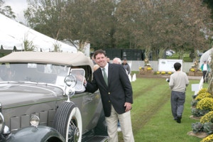 Concours d'Elegance founder, Jeff Cruz of Rumson, with one of the cars on display.