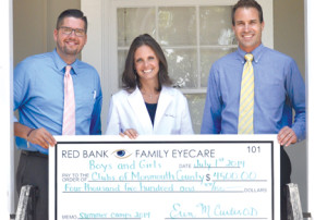Members of the Red Bank Family Eyecare staff present a check to the Boys & Girls Clubs of Monmouth County. Those taking part in the presentation are, from left, Ty Choate, optical manager, and Dr. Erin Curtis of Red Bank Family Eyecare and Douglas Eagles, executive director of the Boys & Girls Clubs of Monmouth County. --Courtesy BGCM