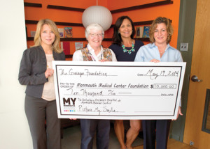 The Grainger Foundation presents a check to start the Picture My Smile program at The Unterberg Children's Hospital at Monmouth Medical Center. Accepting the check are, from left, Tara Kelly, vice president of development, Monmouth Medical Center Foundation; Margaret C. Fisher, M.D., chair of pediatrics and medical director of children's hospital; and Tracy Brown, chair of the medical centers board of trustees and members of the children's hospital council. Representing the Grainger Foundation is Judy Kile, right, market manager, who is also on The Unterberg Children's Hospital Leadership Council.