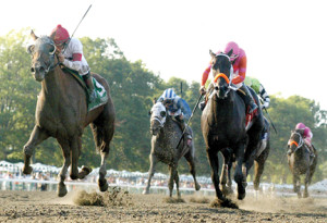 Balance Of Power, No. 5, with Chuck C. Lopez riding, left, wins the $150,000 Grade III Philip H. Iselin Stakes at Monmouth Park in Oceanport on Sunday, Aug. 17. Second, was No. 7, Pants On Fire, right, with Paco Lopez aboard.