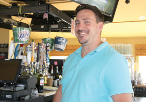 Jay Giberson, a bartender at Windansea restaurant and bar, in Highlands, said good summer weather benefitted business.