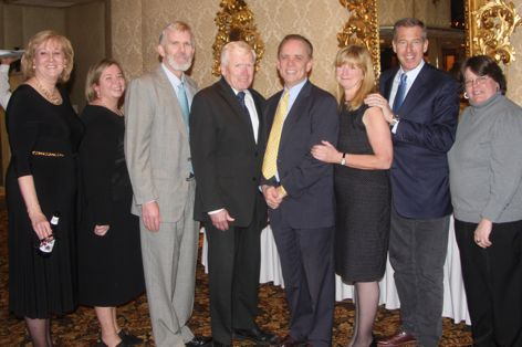 Brian Williams, second from right, poses with classmates from the Class of 1977 at the Mater Dei Fundraising Gala on Saturday, March 21, 2015. Photo: Lynne Ward