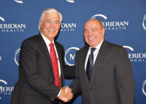 Meridian president John Lloyd, left, with Michael D'Agnes, president of Raritan  Bay Medical Center.