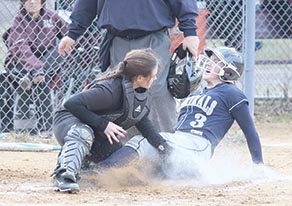 Olivia Iannace (3) of Henry Hudson gets tagged out at home plate by RBR catcher Carly Keeler during Monday's scrimmage. Photo by Sean Simmons.