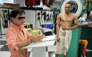 Clerk of Scales Steve Sousonis weighs jockey Christian Santiago Reyes. Photo: Art Petrosemolo